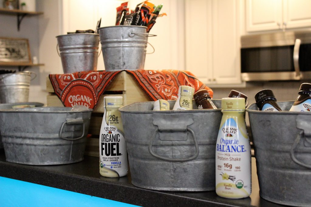 Decoratove metal Buckets are surounded by milk bottles