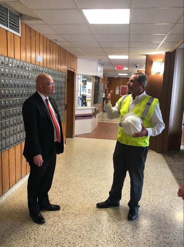 Two men talking in hallway