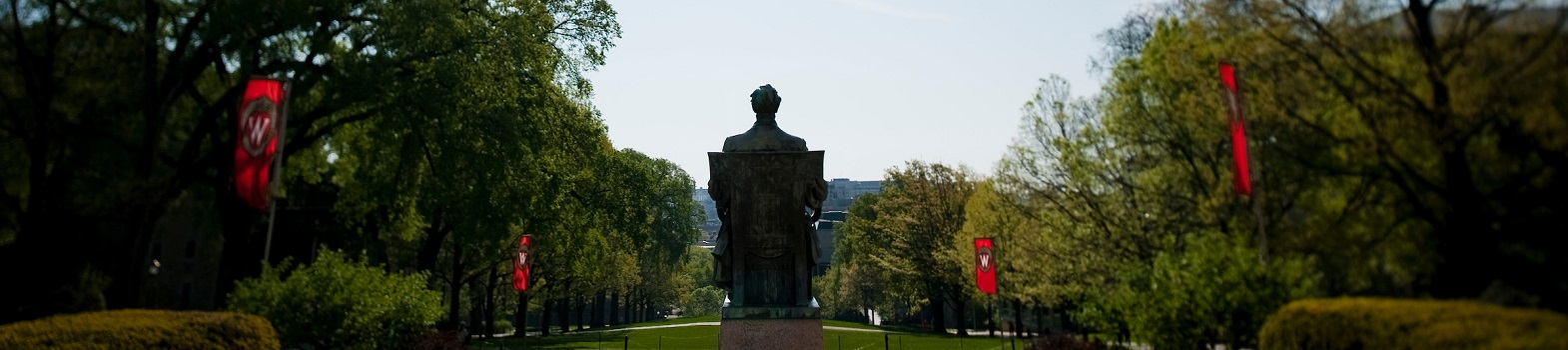 Statue of Abraham Lincoln is surrounded by trees and red banners